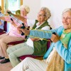 Cheerful senior women exercising their arms.